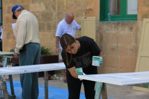 One of the GFI Charity Fund committee members helping out with the paining