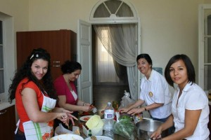 GFI Malta girls helping in the kitchen
